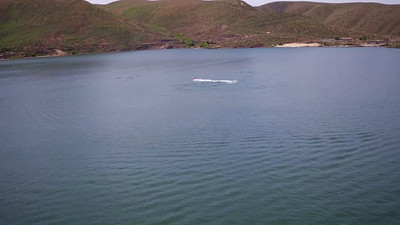 9-Jet skier cavorting behind the Lucky Peak Dam