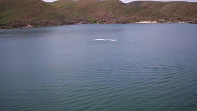 9-Jet skier cavorting behind the Lucky Peak Dam