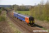 160421-002     East Midlands Trains class 156 sprinter unit no 156411 is seen passing Sutton-in-Ashfield with 2H09, the 10.55 Nottingham to Mansfield Woodhouse.