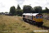 160901-010  On Thursday 1st September 2016 five modified hoppers were handed over to GB Railfreight by WH Davis of Langwith Junction. 66752 The Hoosier State waits in the wings whilst Davis's Barclay 0-6-0DH no 499 shunts the hoppers onto the end of the branch.