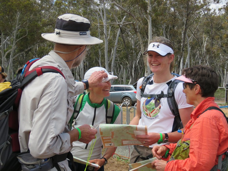 Ron Simpson inspecting Susie Sprague's hat with Claire Edwards and Jean Douglass