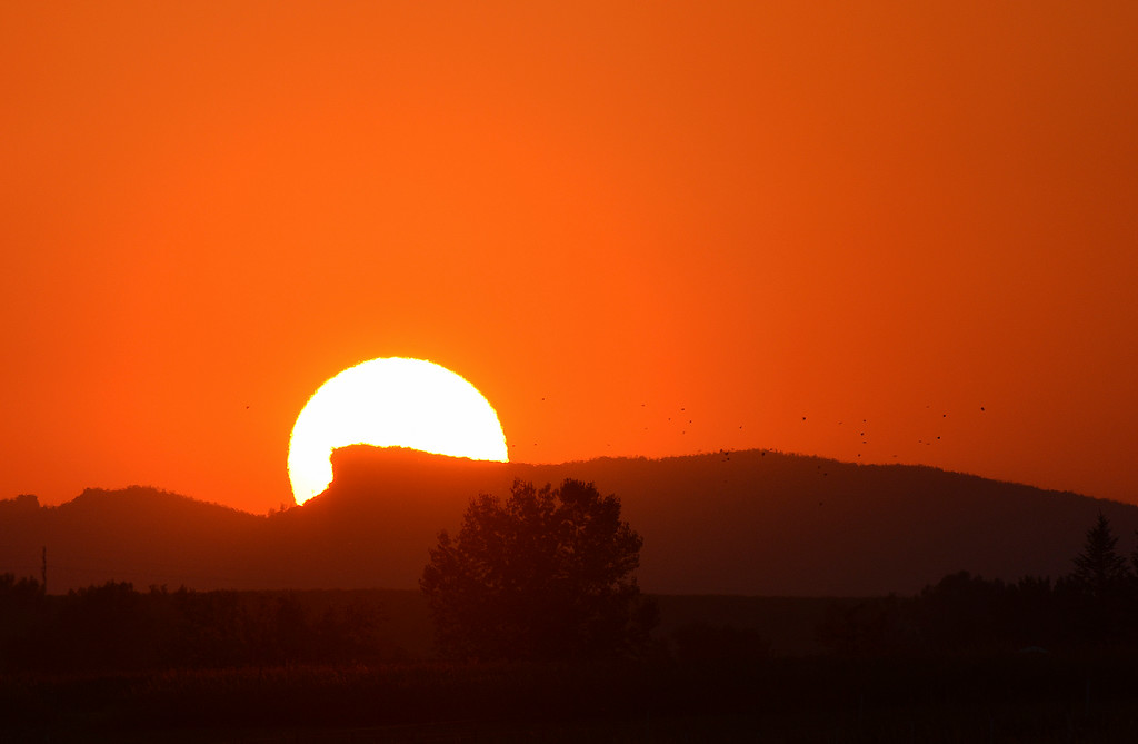Justin Sheely | The Sheridan Press<br /> The sun drops behind Steamboat point as seen from Big Horn Road outside of Sheridan.