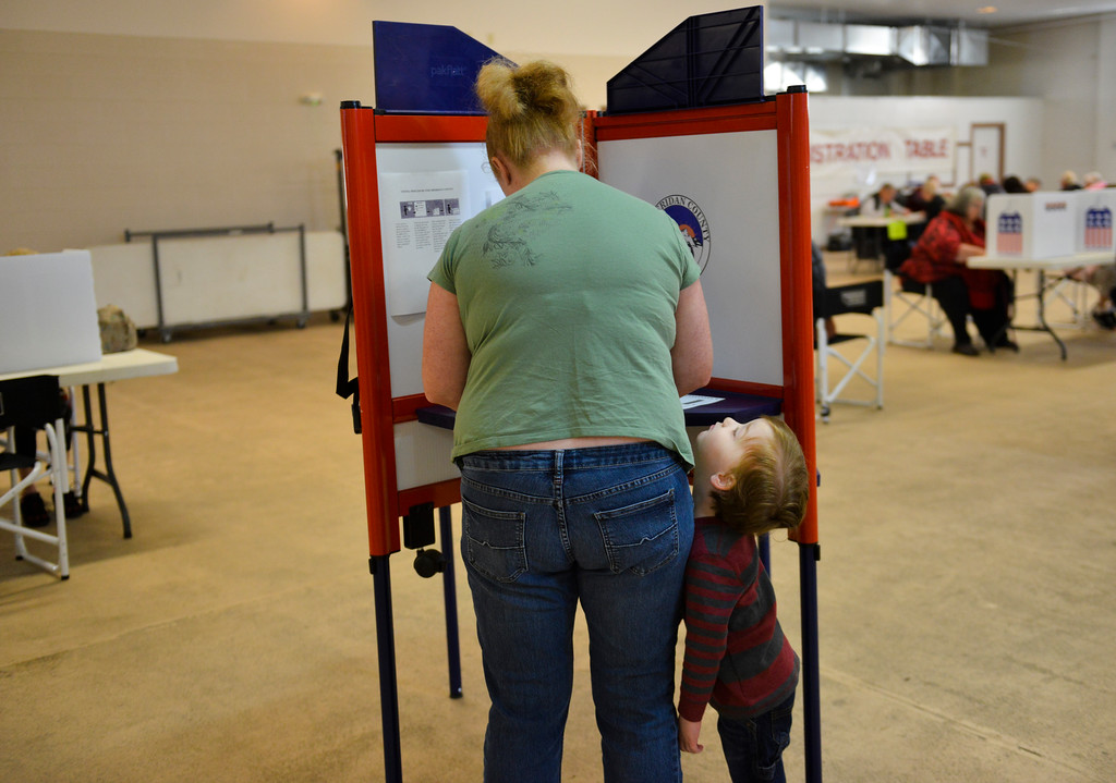 Justin Sheely | The Sheridan Press<br /> Holly Johnston votes has her son Carmine Johnston, 3, waits at the polling station in the Sheridan County Fairgrounds for the General Elections Tuesday.