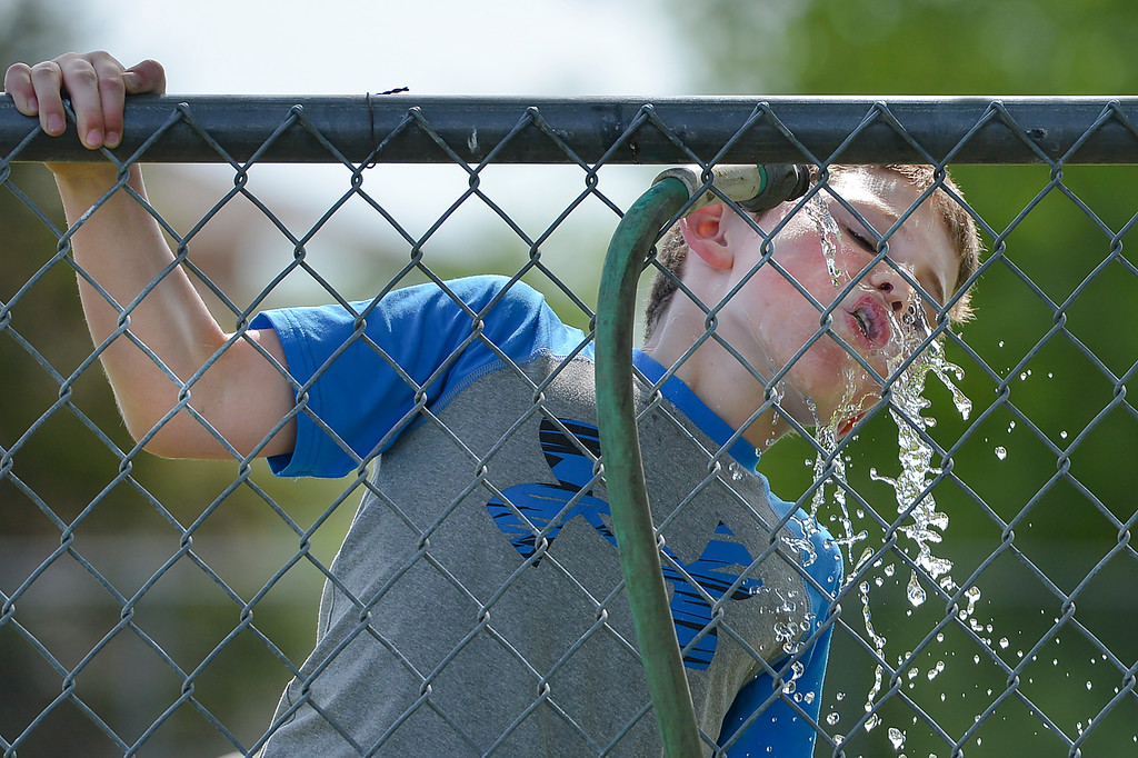 Justin Sheely | The Sheridan Press<br /> The fourth grader Cyrus Andrews sates his thirst during fun day celebration on the last day of school last June at Tongue River Elementary in Ranchester.