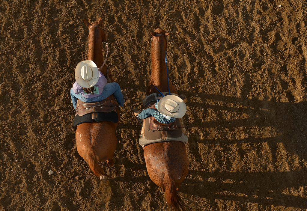 Justin Sheely | The Sheridan Press<br /> Rodeo contestants ride their horses up the track during the Sheridan County Rodeo last August at the Sheridan County Fairgrounds.