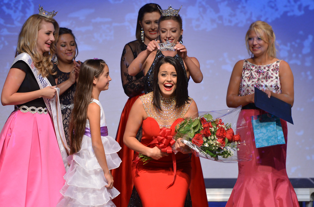 Justin Sheely | The Sheridan Press<br /> Jordan Hall is crowned 2016 Miss Wyoming by 2015 Miss Wyoming Mikaela Shaw during the 2016 Miss Wyoming pageant Saturday, June 25, at the WYO Theater. Miss South Central Jordyn Hall was crowned as the 2016 Miss Wyoming to represent the state during the Miss USA 2016 competition.