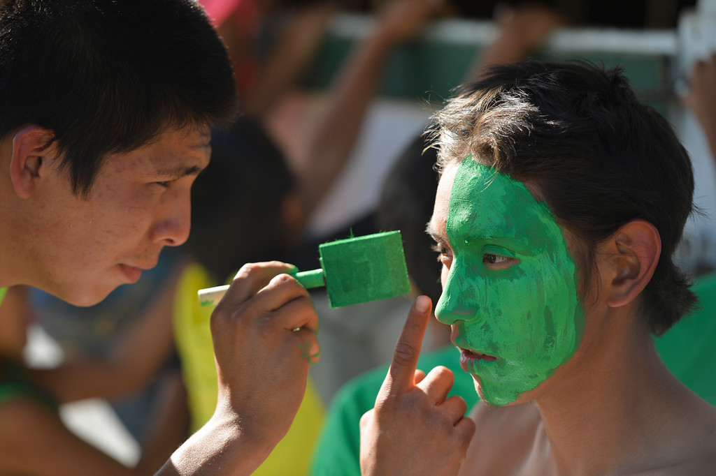 Justin Sheely | The Sheridan Press<br /> Quintin Birding Ground, III, left, paints his brother Kaylob Yellow Mule's face prior to the first night of the World Champion Indian Relay Races during the Sheridan WYO Rodeo last July at the Sheridan County Fairgrounds.