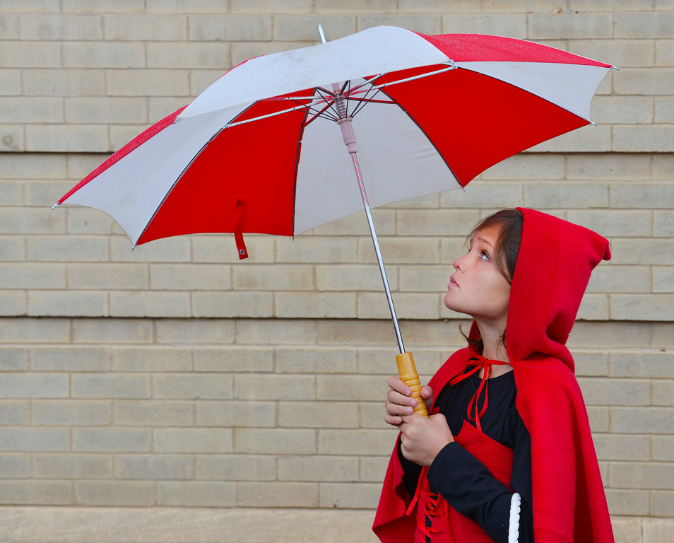 Justin Sheely | The Sheridan Press<br /> Ten-year-old Callista Roush stands under her umbrella during the Sheridan Jaycees Halloween Parade last October outside of City Hall in downtown Sheridan.