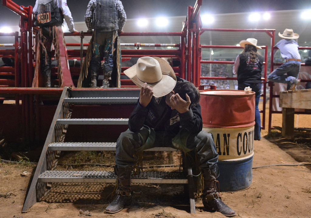 Justin Sheely | The Sheridan Press<br /> A Bull rider takes moment by himself behind the bucking chutes during the final night of Sheridan WYO Rodeo last July at the Sheridan County Fairgrounds.