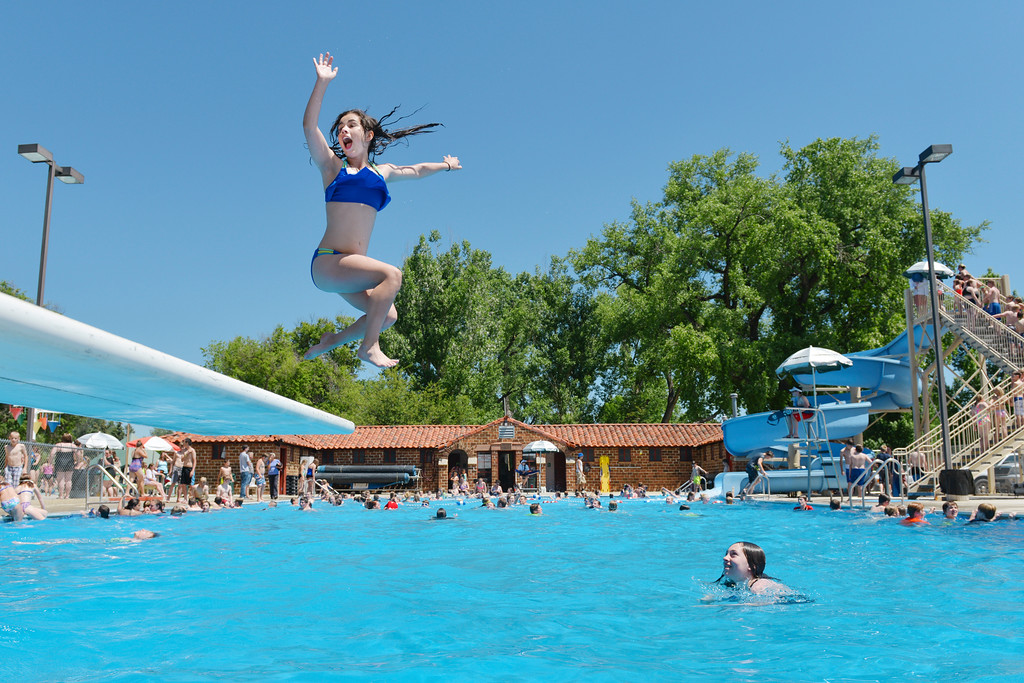 Justin Sheely | The Sheridan Press<br /> Thirteen-year-old Jadyn DeTavernier leaps from the diving board on the opening day of Kendrick Park Pool.