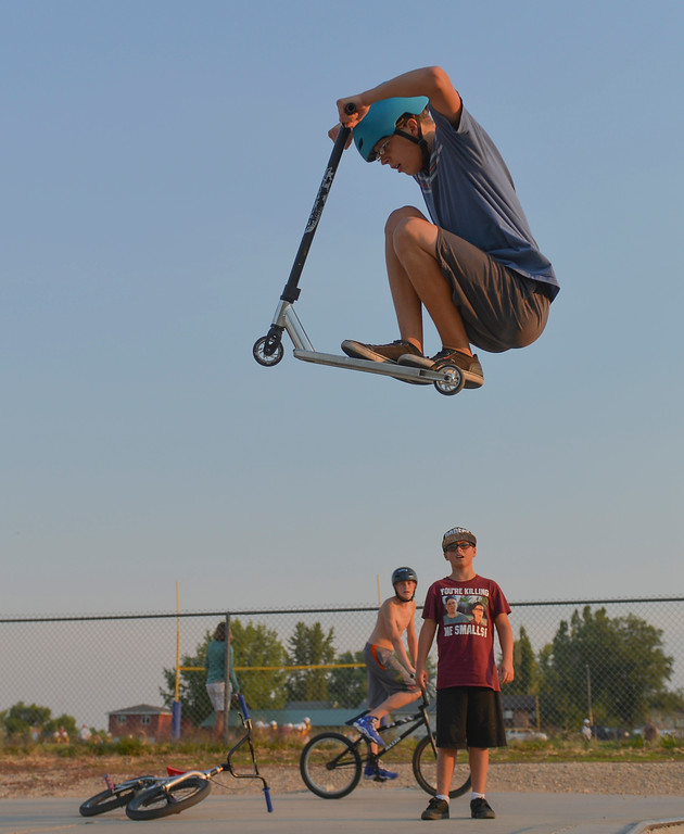 Justin Sheely | The Sheridan Press<br /> Sixteen-year-old Riley Poprycz gets some air as others watch last August at the skate park at Thorne-Rider Park.