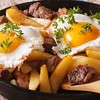44755737 - austrian food: fried potatoes with meat, ham and eggs in a pan close-up. horizontal