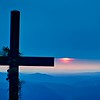 christian worship cross overlooking mountains at sunrise