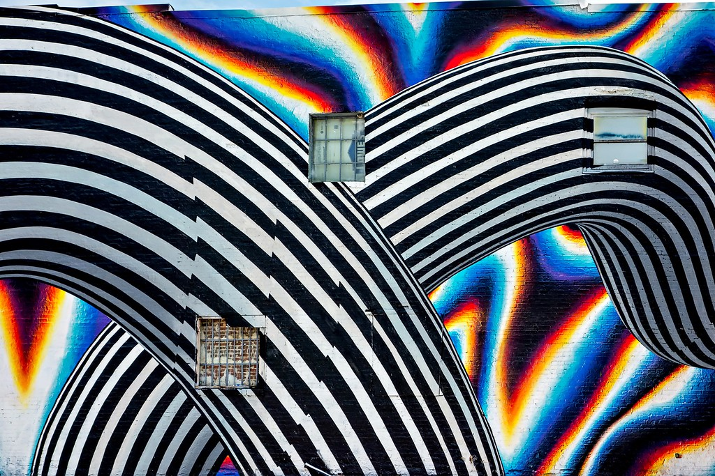 Beautiful street art of graffiti. Abstract color creative drawing fashion on walls of city. Urban contemporary culture.