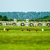 Targets for a shooting range with bulls-eye's are lined up in a row.