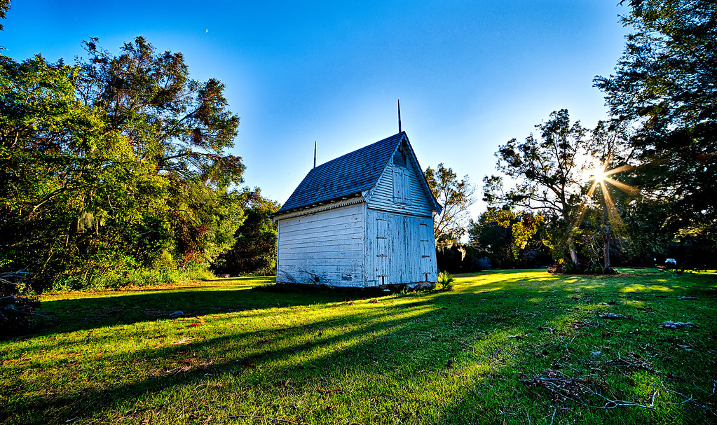 historic chapel building with sunset