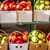 apples in basket on farm stand