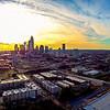 sun setting over charlotte north carolina skyline aerial