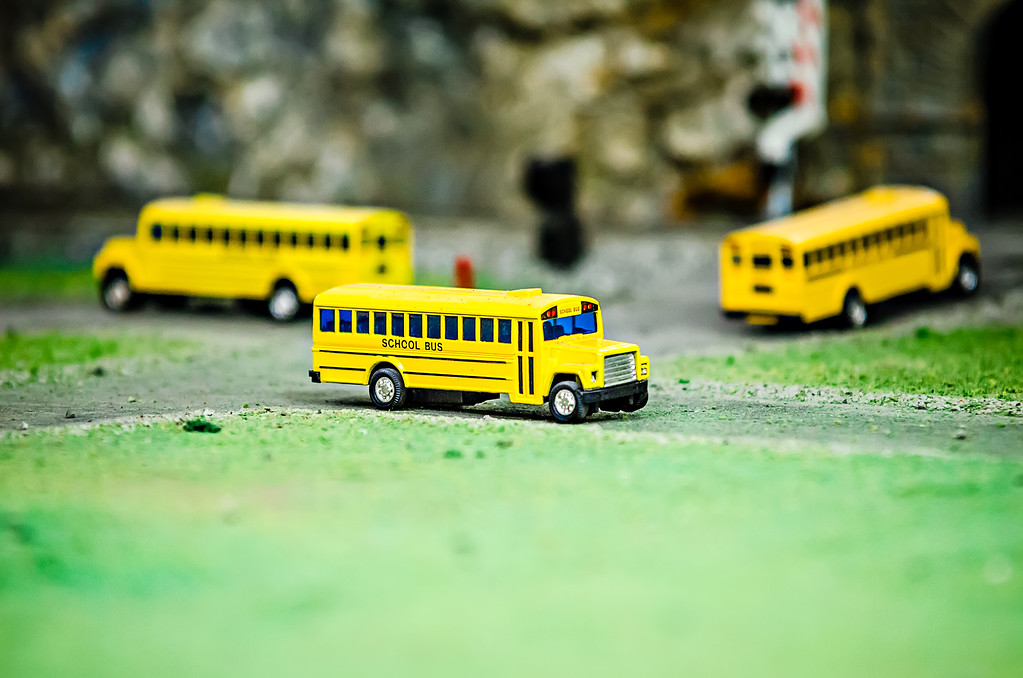 yellow school bus plastic and metal toy model