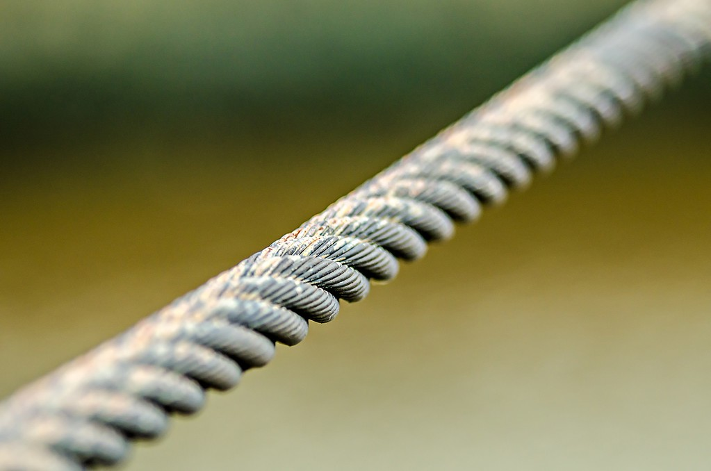tight steel cable on blury background