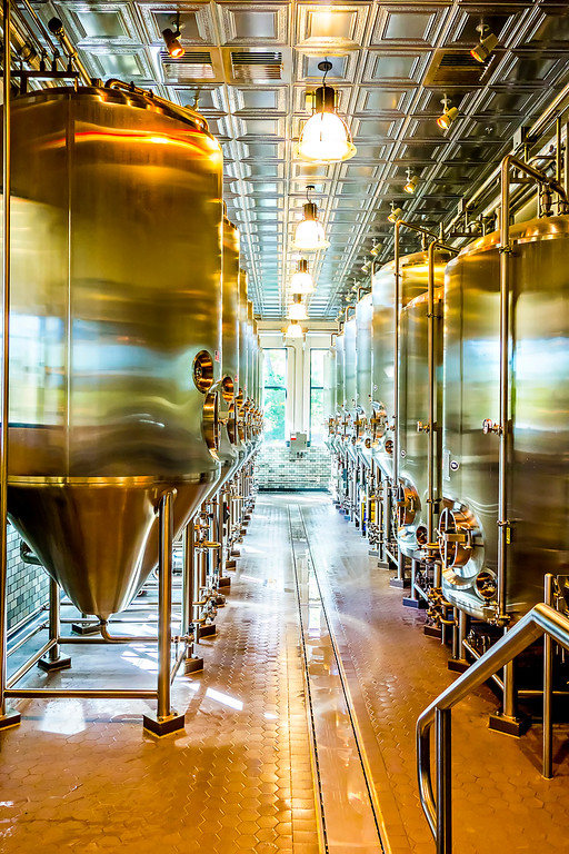 Modern beer plant (brewery) with brewing kettles  vessels  tubs and pipes made of stainless steel