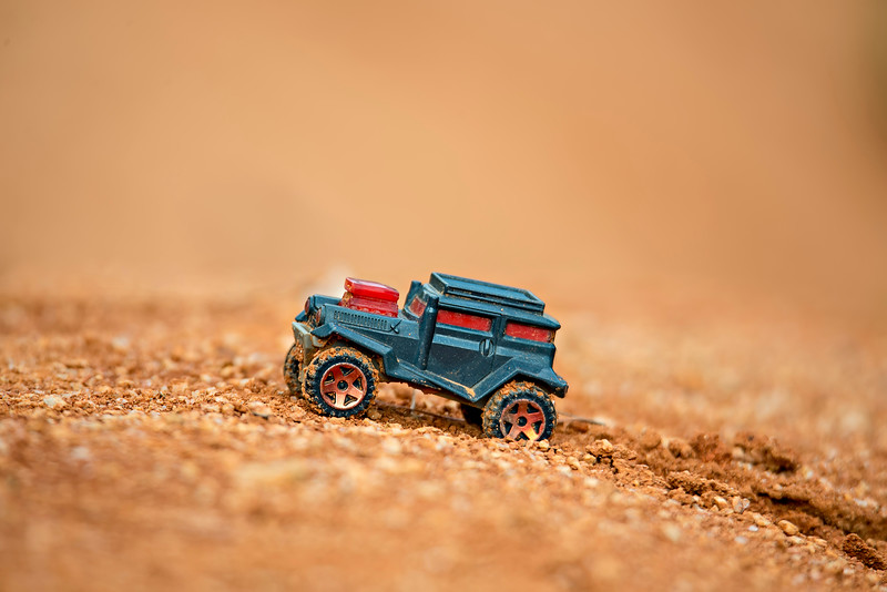 toy truck offroading on mud with soft focus and beautiful bokeh