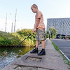 Nederland, Amsterdam, 25 september 2016, vissen vangen, catching fish, foto: Katrien Mulder