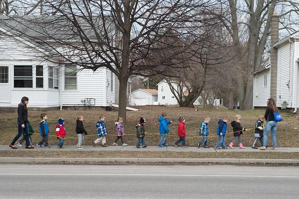 JOED VIERA/STAFF PHOTOGRAPHER- Newfane, NY-Teachers walk kids from Tiny Town Day Care down Main Street.