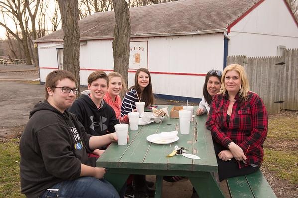JOED VIERA/STAFF PHOTOGRAPHER- Lockport, NY-Hayden Frain, Zac Burdick, Maddie Doel, Lauren Smith, Julie Doel and Krissie Frain finish up dinner on a picnic table at Reids.