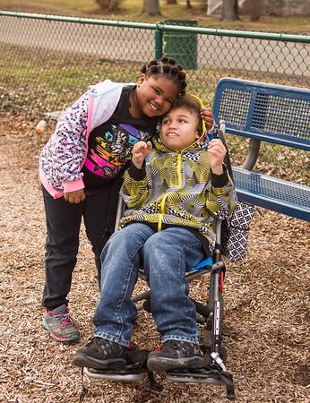 JOED VIERA/STAFF PHOTOGRAPHER- Lockport, NY-Keyanna Smith 7 hugs her brother Trevon Smith 12 at Dolan Park.