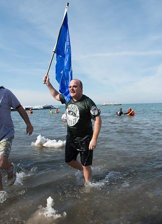 JOED VIERA/STAFF PHOTOGRAPHER- Olcott, NY-Mike Barclay jumps into Lake Ontario during the Polar Bear Swim.