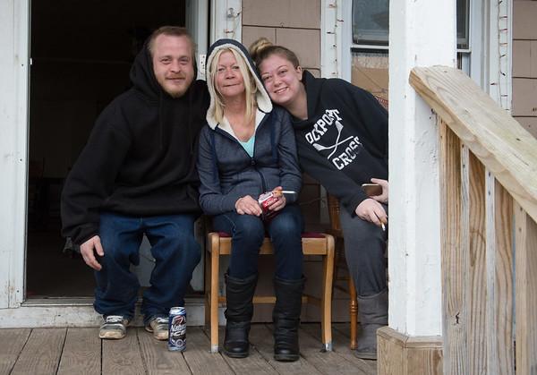JOED VIERA/STAFF PHOTOGRAPHER- Lockport, NY-Nick Zimmerman, Cindy Hueber and Lisa Paladino sit on a Washburn Street porch.