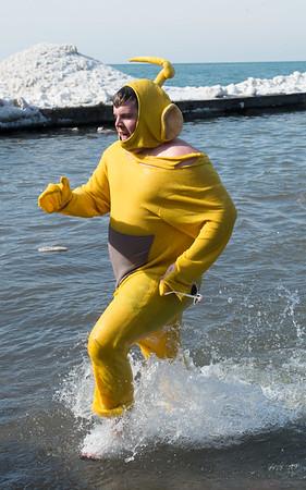 JOED VIERA/STAFF PHOTOGRAPHER- Olcott, NY-A man runs out of  Lake Ontario during the Polar Bear Swim.