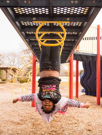 JOED VIERA/STAFF PHOTOGRAPHER- Lockport, NY-Keyanna Smith 7 hangs upside-down at Dolan Park.