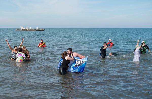 JOED VIERA/STAFF PHOTOGRAPHER- Olcott, NY-Swimmers jump into Lake Ontario during the Polar Bear Swim.