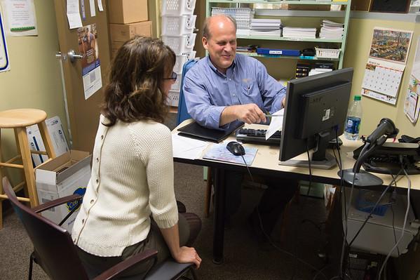 JOED VIERA/STAFF PHOTOGRAPHER- Middleport, NY- Pharmacist Stephen Giroux speaks to Ruth Verratti.
