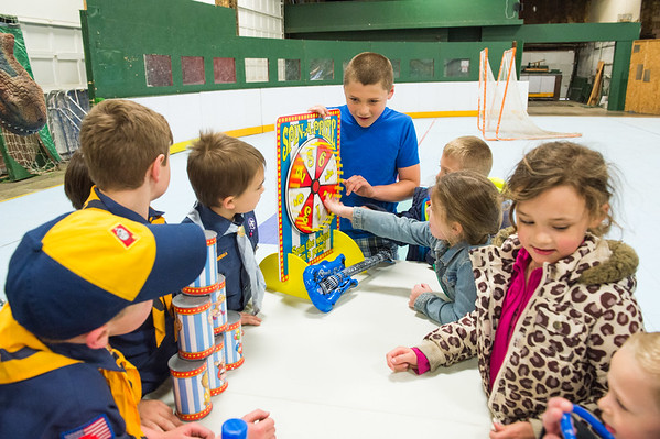 JOED VIERA/STAFF PHOTOGRAPHER-Lockport, NY-Kids practice playing games that Rapids Fire Hall Cub Scout Pack 3071 set up  at the Kenan Arena.