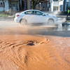 JOED VIERA/STAFF PHOTOGRAPHER- Lockport, NY-A whirlpool forms at a water main break on East Avenue at McCollum Street.