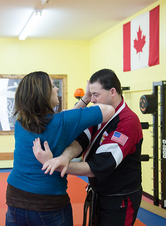 JOED VIERA/STAFF PHOTOGRAPHER- Lockport, NY-Melissa Miller practices a self-defense technique on Ken Meier at Karate Ken's.