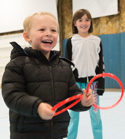 JOED VIERA/STAFF PHOTOGRAPHER-Lockport, NY-Bryson Hummel and Emma McQuestion practice playing games that Rapids Fire Hall Cub Scout Pack 3071 set up  at the Kenan Arena.
