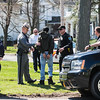 JOED VIERA/STAFF PHOTOGRAPHER- Lockport, NY-A suspect in a robbery that occured on Saxton Street and Lagrange Street is questioned by Lockport Police, NY State Police and Niagara County Sheriffs Deputies.