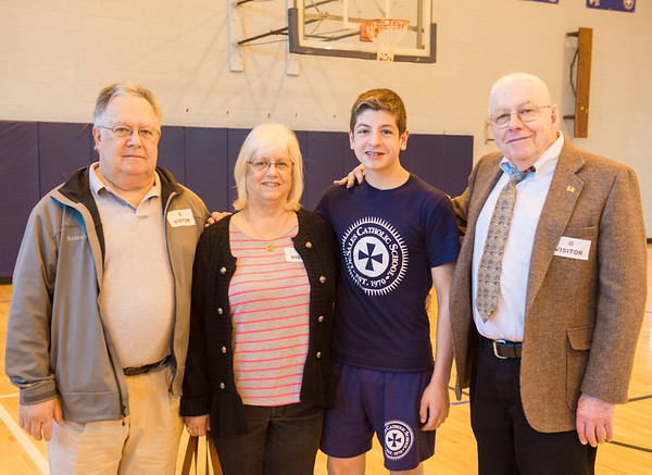 JOED VIERA/STAFF PHOTOGRAPHER- Lockport, NY-Joe Angelone, Marlene Angelone and Roy Crocker stand with their grandson, Mark Crocker, 14, at DeSales Catholic School.