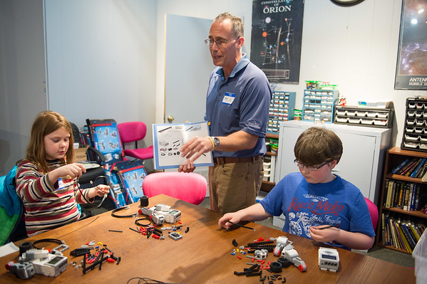 JOED VIERA/STAFF PHOTOGRAPHER- Lockport, NY-Michael Lieber shows Donovan Monaco and  Trever LeFeve the next step in a model they are building during Lego League at the Challenger Learning Center.