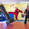 JOED VIERA/STAFF PHOTOGRAPHER-Lockport, NY-Ken Meier watches Sarah Hahn 12 perform a kick at Karate Ken's.