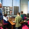 JOED VIERA/STAFF PHOTOGRAPHER- Lockport, NY-Michael Lieber shows Lego League participants a step in a vehicle they are building at the Challenger Learning Center.