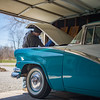 JOED VIERA/STAFF PHOTOGRAPHER- Wilson, NY-Joe Schrader tunes up the 1956 Ford Crown Victoria his grandfather gave him earlier this spring.