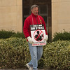 JOED VIERA/STAFF PHOTOGRAPHER- Lockport, NY- A CWA member yawns as he  pickets outside of the Verizon building on Walnut Street. Wednesday marks the begining of the third week the union has been on strike. Reportedly close to 800 Western New York workers have been out of work since the strike began on April 13.