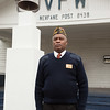 131107 Vet Poppy JOED VIERA/STAFF PHOTOGRAPHER Newfane, NY-Retired  U.S. Marines Sgt Michael Richardson stands in front of Newfane's VFW post on Thursday Nov 7th, 2013.