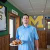 JOED VIERA/STAFF PHOTOGRAPHER- Lockport, NY-Nate Ennis holds the Corn Beef and Cabbage Eggrolls at Ennis' West End Tavern.