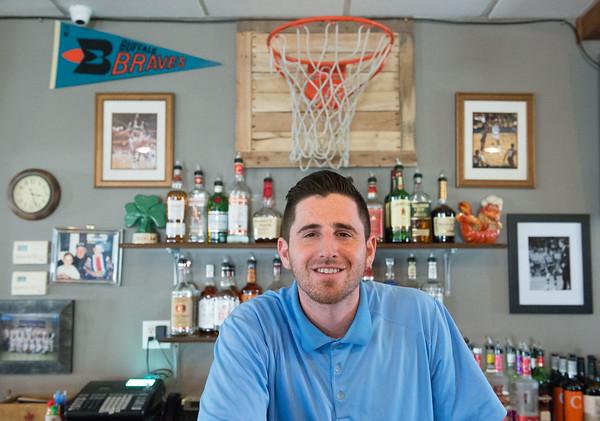JOED VIERA/STAFF PHOTOGRAPHER- Lockport, NY-Nate Ennis stands behind Ennis' West End Tavern bar.